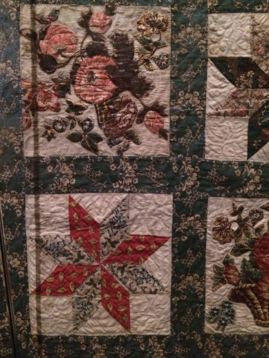 Antique Quilt at Williamsburg Museum Featuring Btoderie Perse and 8 Pointed Star