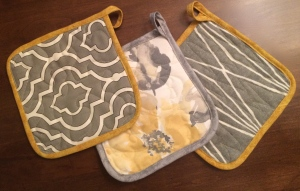 Gray and yellow potholders